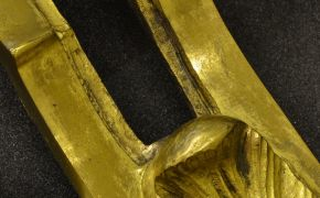 Figure 4. Past abrasive treatments have worn through the gilding on this mount (object 1028-1882)