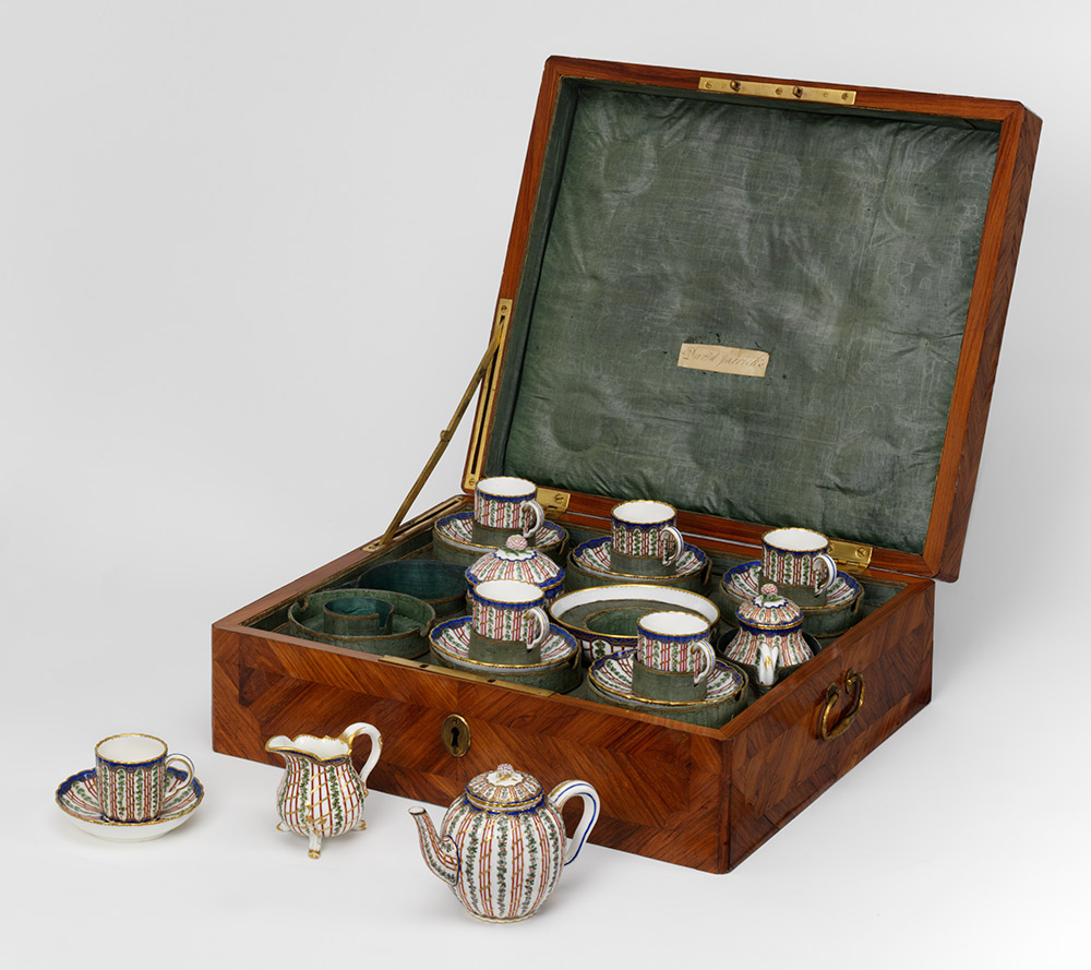 Tea set in travelling case, made at the Sèvres factory, 1764-65, France (Paris), porcelain painted with enamels and gilded; case: oak veneered with tulipwood; watered silk lining. Museum nos. C.57 to 74-2011, © Victoria and Albert Museum, London