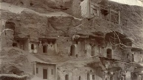 Cave shrines in rock face, Dunhuang, Sir Marc Aurel Stein, 1914. Photo 392/29(106),  The British Library Board