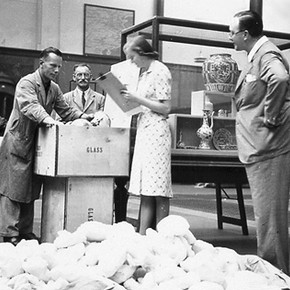 Ceramic objects being packed, about 1939.