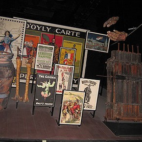 Figure 3. A Theatre Museum display before de-installation showing large, heavy and awkward objects such as a billboard poster, a wind machine and props including an Ali Baba pot, and ostrich legs (Photography by Merryl Huxtable)