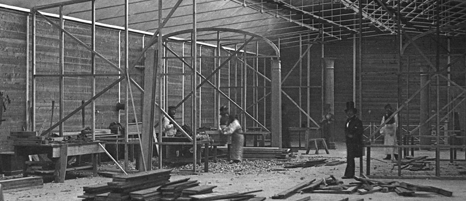Interior view of the South Kensington Museum (the 'Brompton Boilers') under  construction, 1856. Museum no. 33:951. © Victoria and Albert Museum, London.