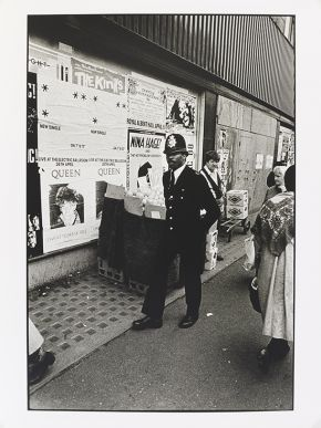 Normski, 'Black Police Officer - Camden High Street, Camden Town', 1984. Museum no. E.107-2012. © Normski/ Victoria and Albert Museum, London. Supported by the National Lottery through the Heritage Lottery Fund.