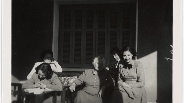 Black and white photograph of a family seated outside