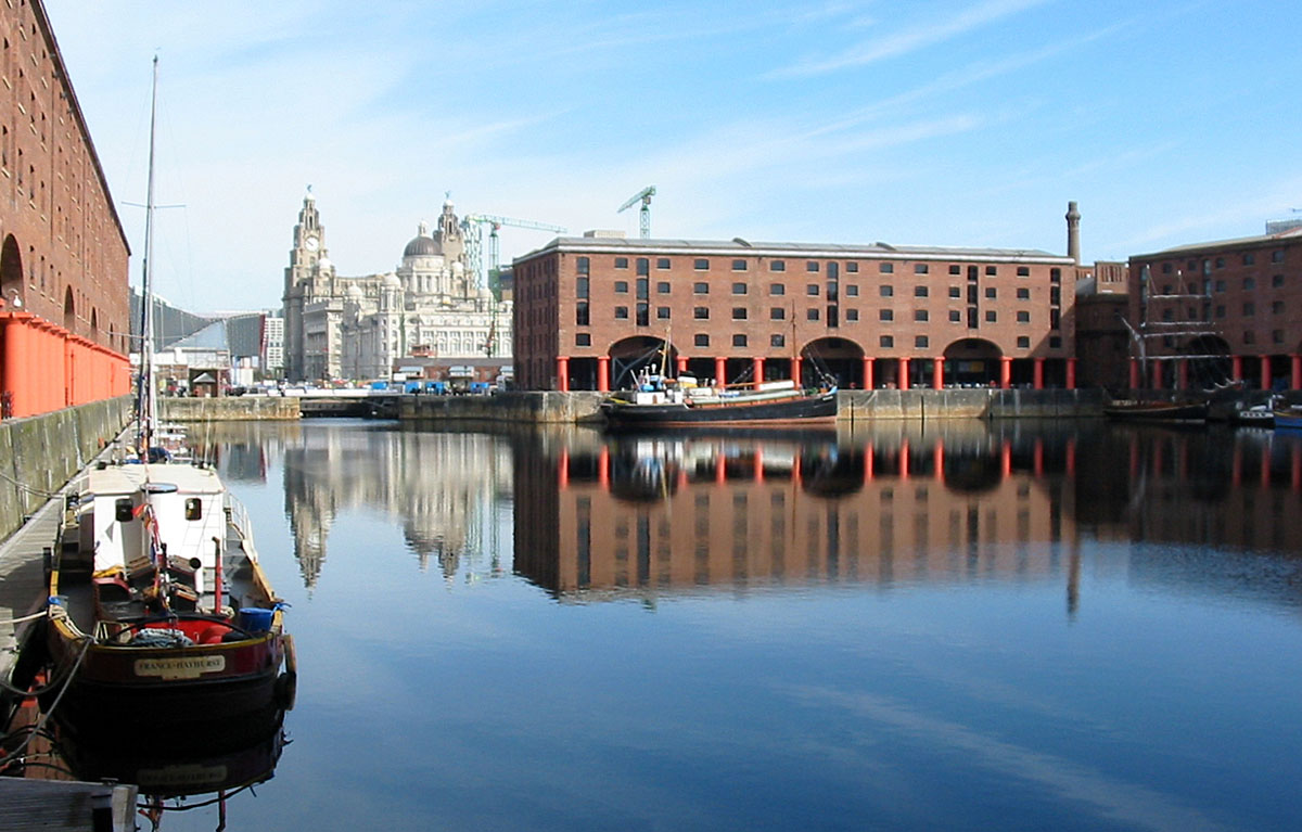 Albert Dock in Liverpool, with a boat in at the foreground