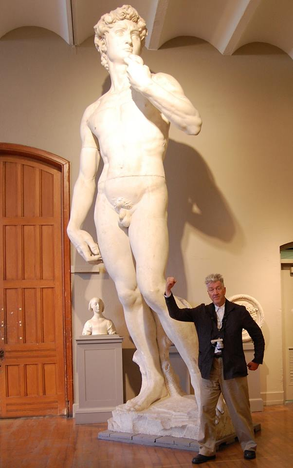 David Lynch posing next to Michelangelo's David at PAFA. Image, courtesy of the Pennsylvania Academy of the Fine Arts.