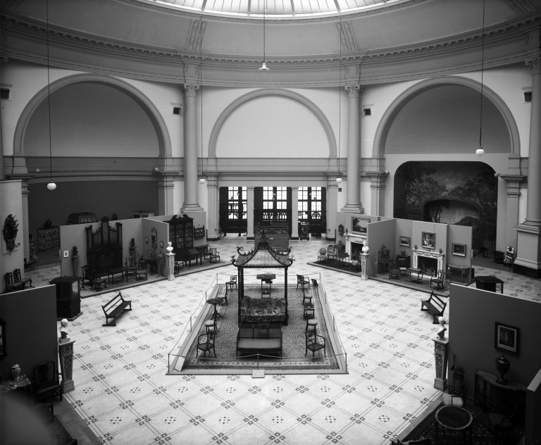 Central View of The Octagon Court ; with room sets displays;