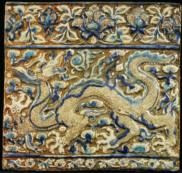 Yellow and blue ceramic tile showing a dragon