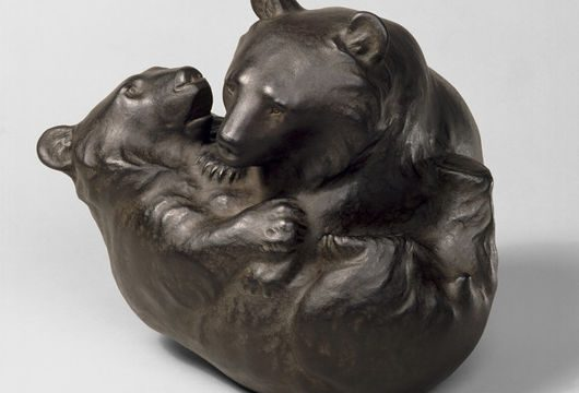 Sculpture of two bear cubs wrestling