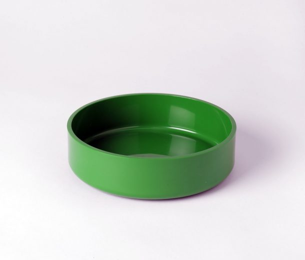 A green bowl made from heavy-duty ABS resin containers