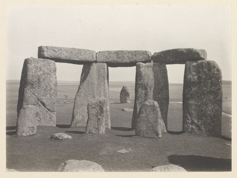 Black and white photograph of Stonehenge showing the Heel Stone.