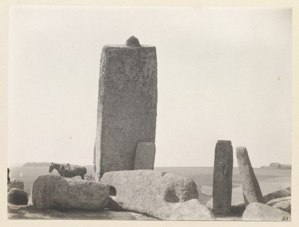 Black and white photograph of a standing stone at Stonehenge.