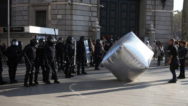 Inflatable cobblestone, action of Eclectic Electric Collective in cooperation with Enmedio collective during the General Strike in Barcelona 2012. © Oriana Eliçabe/Enmedio.info