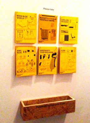 Photograph of the take home How-To Guides in the exhibition