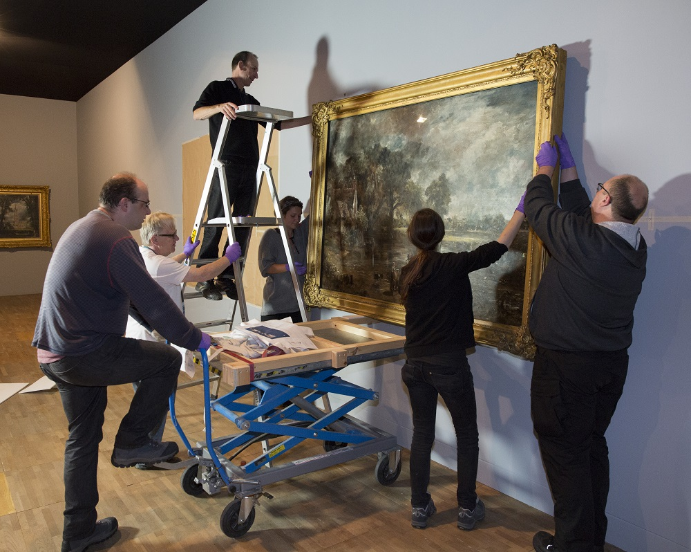Technicians install 'The Hay Wain' (full-size sketch).
