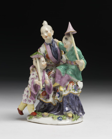 The Meissen factory in Saxony made several models, including this one, after a series of chinoiserie designs by Boucher entitled 'Les  Délices de L'Enfance' (The Delights of Childhood), inspired by engravings by J.J. Balechou. V&A C.6-1978