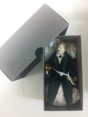 Character from Betty Pinney's house in his custom-made box.