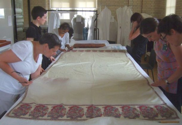 The team marvel at the fineness of a Kashmir shawl