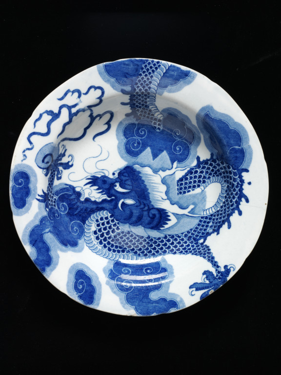 Plate Made in Staffordshire, about 1810-1820 Mark: imitation of a Chinese emblem, printed in blue Lead-glazed earthenware 55-1870