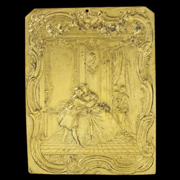 Gilded copper alloy plaque depicting a love scene after an illustration by F. Boucher. Plaque signed and dated by 'P Suther', Paris, 1748. V&A M.310-1919
