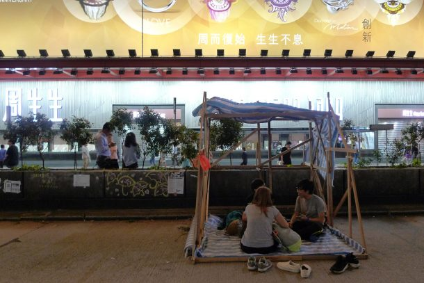 A shelter built by occupiers opposite a large jewellery store at Nathan Road, Mong Kok.