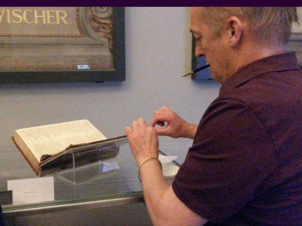 Conservator repairing a first folio
