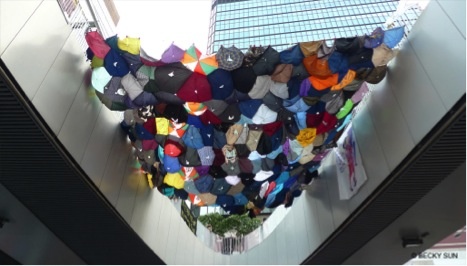 Installation from Baptist University students made from umbrella fabric hanging across footbridges leading to the Central Government Offices, above the self study area in Admiralty.  ©Becky Sun.