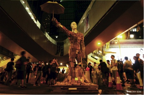 Umbrella Man sculpture in Admiralty  by Milk, who was inspired by a photo of a protester shielding a police officer from the rain with his own umbrella. ©Becky Sun.