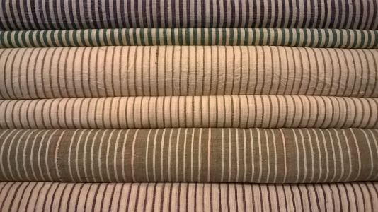 Stack of striped hand woven Indian cotton at Merchant & Mills