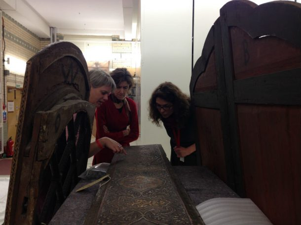 Anke Scharrahs (left) assessing the wooden panels with V&A conservators Vicky Oakley (centre) and Charlotte Hubbard (right) © Mariam Rosser-Owen