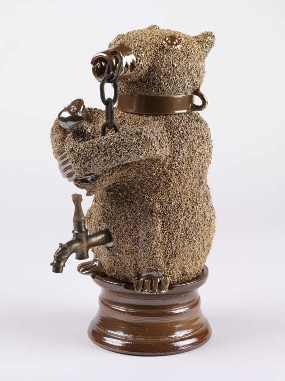 Water cistern with detatchable drinking cup, modelled as a chained bear clasping a cub to its breast