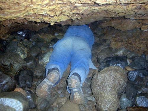Legs of a woman spelunking