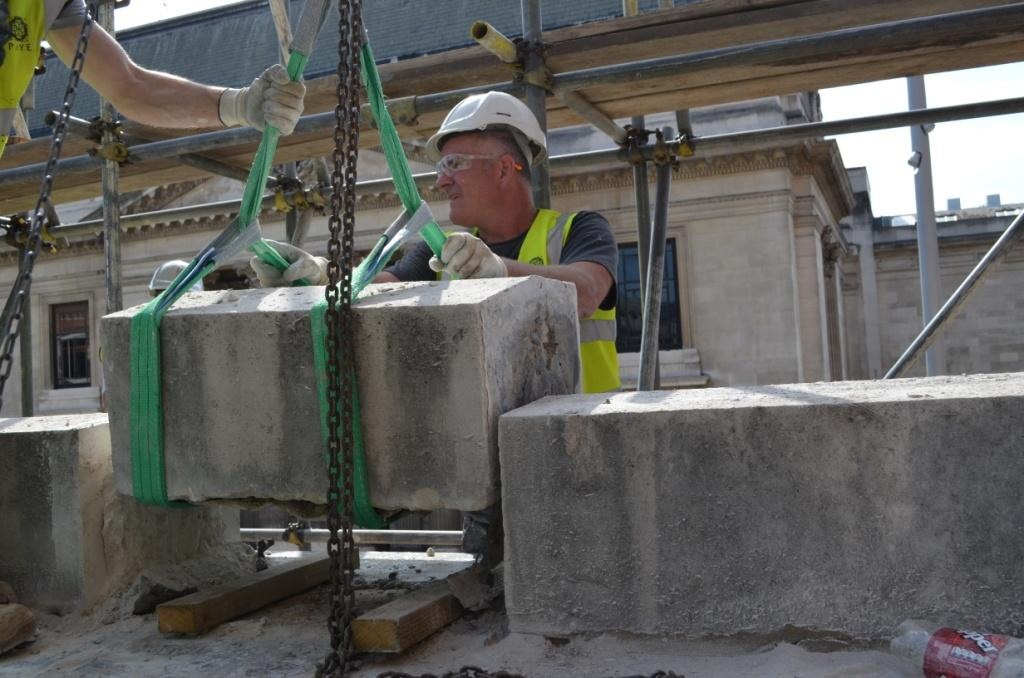 Expert stonemasons carefully removing the Aston Webb Screen for construction. The stones are currently in safe storage until their re-installation in 2016, 2012 © Victoria and Albert Museum, London