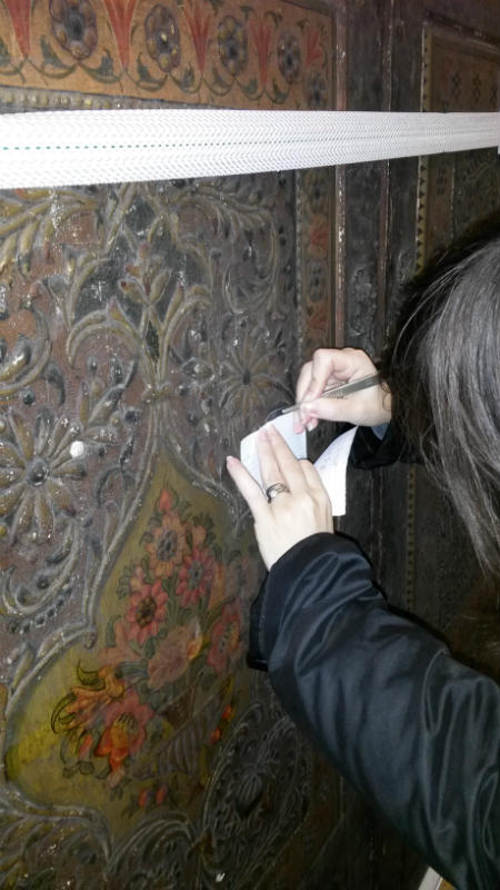 Conservation scientist Dr Lucia Burgio taking a tiny sample from the varnished decoration © Victoria and Albert Museum