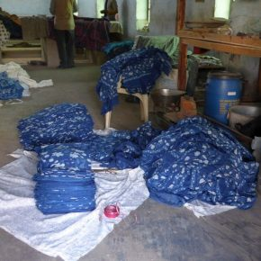 Fabric being folded and stacked into bales for collection.