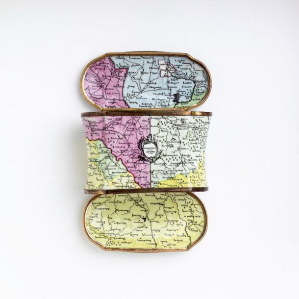 Double snuffbox with both cover and lid hinged to open, made of copper painted overall in opaque enamels with maps of Germany showing various  troop movements, one dated October 1756.