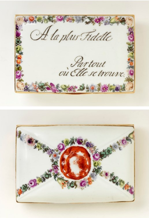 Example of a snuffbox decorated as a sealed letter. The inscription translates as ''To the most faithful, wherever she is found.' Gold, porcelain. Meissen, ca. 1755. V&A LOAN:GILBERT.501-2008