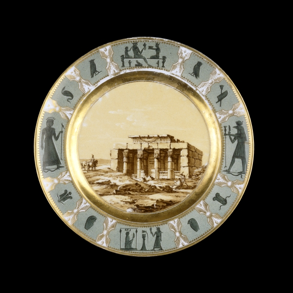 Sèvres porcelain plate showing the Temple of Contra Latopolis (modern Esna), painted by Jacques-François Swebach-Desfontaines (1769-1823). Thisplate was possible a trial piece for the service. © Trustees of the British Museum