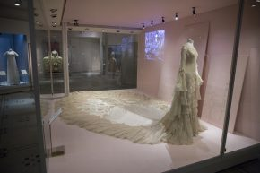 Margaret Whigham's wedding dress by Norman Hartnell, 1933, safely installed in its case.  © V&A Collection