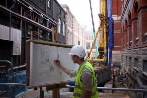 Liam O'Connor starts the scroll in the midst of the building work