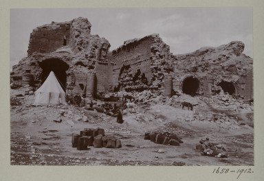 1658-1912 Photograph Photograph depicting a settlement with horses and piles of supplies in the ruins of Hatra, Iraq. Iraq