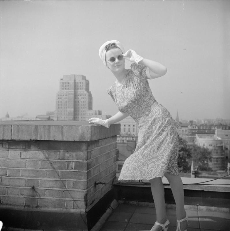 How_a_British_Woman_Dresses_in_Wartime-_Utility_Clothing_in_Britain,_1943_D14786