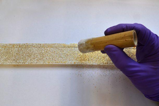 Sprinkling Japanese gold nashiji flakes ©Tristram Bainbridge