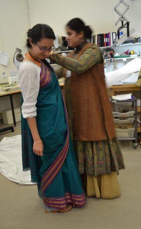 Textile Conservator Deepshikha Kalsi teaching sari draping