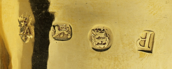 London gold hallmarks for 1717-18, left to right: maker or sponsor mark for Paul De Lamerie; lion passant used to denote either sterling silver or 22ct gold; crowned lion or leopard head for the London Goldsmiths Company; date letter B for 1717-18.