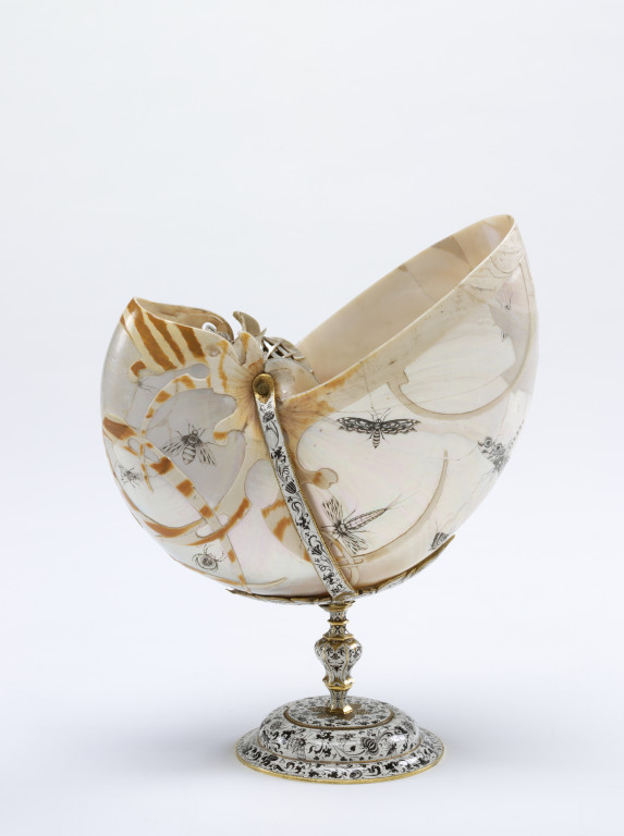 Nautilus shell etched and engraved; enamelled gold mount. 1621-1640 M.179-1978