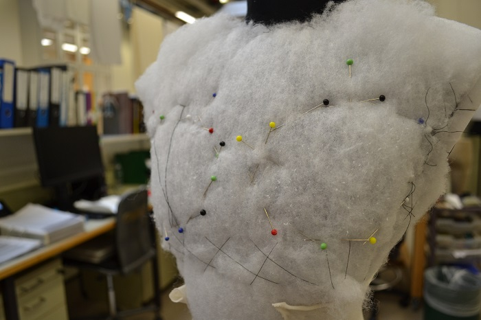 Marking out the position of the breasts using coloured pins
