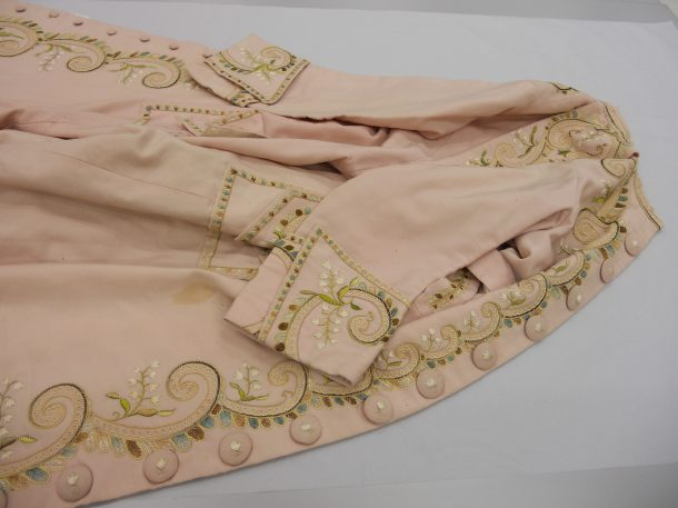 A silk dressing gown from 1875 (T.193-1984) being assessed © V&A Collection