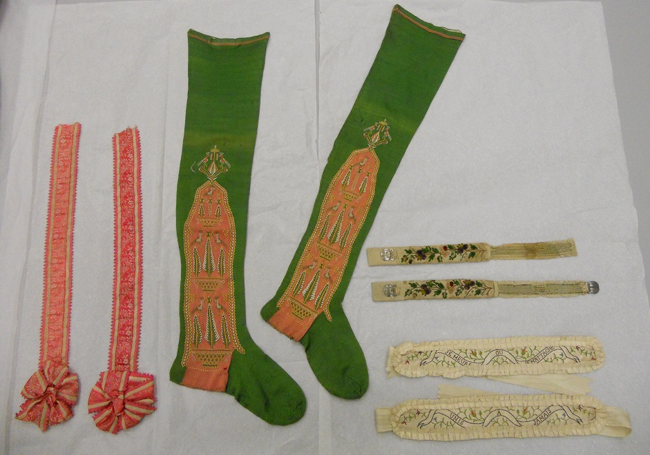 The assessments continue with a pair of 19th garters (T.1813-1913) and a pair of 18th century stockings (T.156-1971) © V&A Collection
