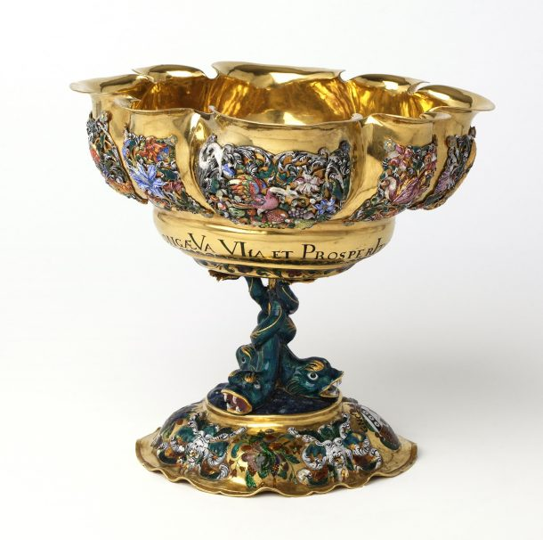300 years have left their trace on the gold cup as this image shows. It also shows the grotesque faces on the foot